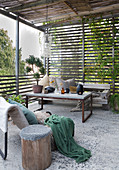 A cosy terrace with a coffee table and a bench