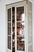 Shabby display cabinet with dishes