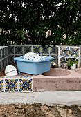 Bathtub next to the sink in a Mediterranean outdoor kitchen