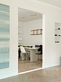 A passage to a dining room with a ladder as wall decoration