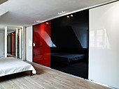 Floor-to-ceiling closet with sliding doors in a spacious bedroom