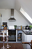 Modern kitchen under the eave with skylight