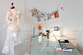 Dress form next to a desk