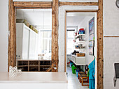 Half-timbering with a mirror and an open door leading to a children's room