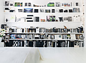 Shelves and picture rails with books, pictures and odds and ends
