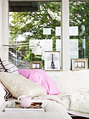 Day bed in front of window with pictures of Eiffel Tower
