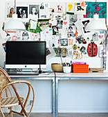 Photos, childhood pictures and memories on the wall above a desk
