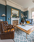 Chesterfield armchair in classic living room decorated in blue