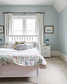 Pretty bedroom with pale blue walls
