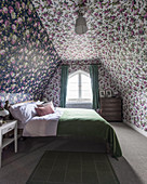 Floral wallpaper in attic bedroom with sloping walls