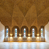 Religious room with stained-glass windows and vaulted ceiling