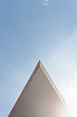Projecting pointed building element against blue sky