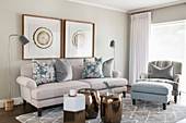 Classic living room in shades of grey with bronze accents