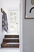 Vintage steps, with cloakroom strips above in the entrance area