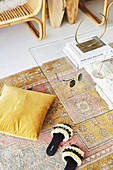 Coffee table with glass top, carpet, pillows and slippers