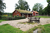 Falu red Swedish house with farmyard and cottage garden