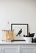 Picture of bird, handcrafted tent model and bowl of fruit