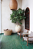 Green herringbone floor tiles on Oriental-style terrace
