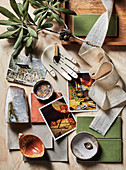 Material and color concept for earthy living rooms (ceramics, textiles, postcards)