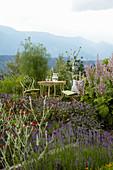Ornate garden furniture in idyllic seating area