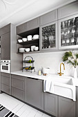 Light gray fitted kitchen with ceramic sink
