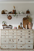 Old chest of drawers and rustic flea-market accessories