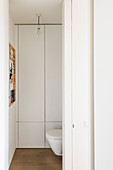 View through open sliding door into guest WC