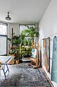 Houseplants in artist's studio with painted floor