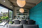 Modern dining room with blue wall in summerhouse