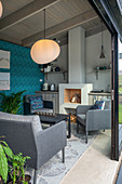 Living space with open fireplace and kitchenette in summerhouse