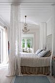 Romantic bedroom in Scandinavian style with canopy