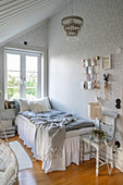 Single bed with valance below window in vintage-style bedroom
