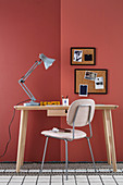 Handcrafted, Viennese cane pinboards on red-painted wall above desk and chair