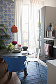 Round dining table in small, blue-and-white kitchen-dining room