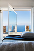 Sea view from bedroom through open swivelling window
