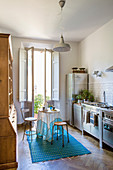 Rustic wooden cupboard, turquoise accents and stainless steel kitchen units