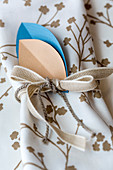 Handmade napkin ring made from paper and ribbons