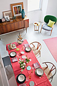 View of set dining table from mezzanine in small apartment