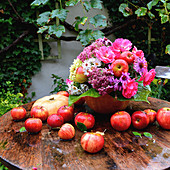 Autumn bouquet with apples and rose petals