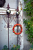 Wreath of ornamental apples on a decorative element