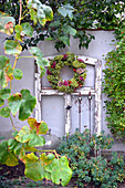 Autumn wreath on the old window frame
