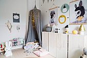 Sideboard and cosy den in contemporary child's bedroom