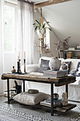 Rustic DIY coffee table made from untreated wooden boards and metal frame