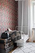 Extendable metal bed in vintage-style nursery