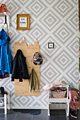 Handmade, plywood children's coat rack with mountain motif