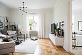 Classic monochrome living room with parquet floor