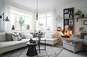 Collage of pictures in cosy, Scandinavian-style living room