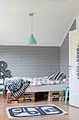 Black-and-white graphic wallpaper in child's bedroom