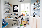 Wooden desk and sideboard in teenager's bedroom with white floor