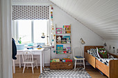 Extendable bed under sloping ceiling in child's bedroom
